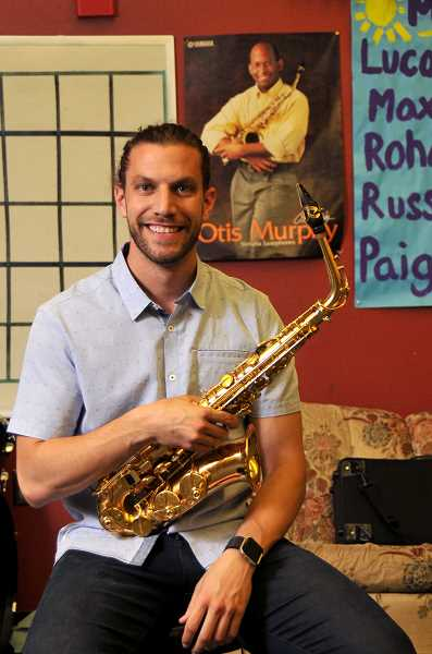 REVIEW PHOTO: VERN UYETAKE - 'I've been able to live out my dream' of being a music teacher, Corey Alston says.