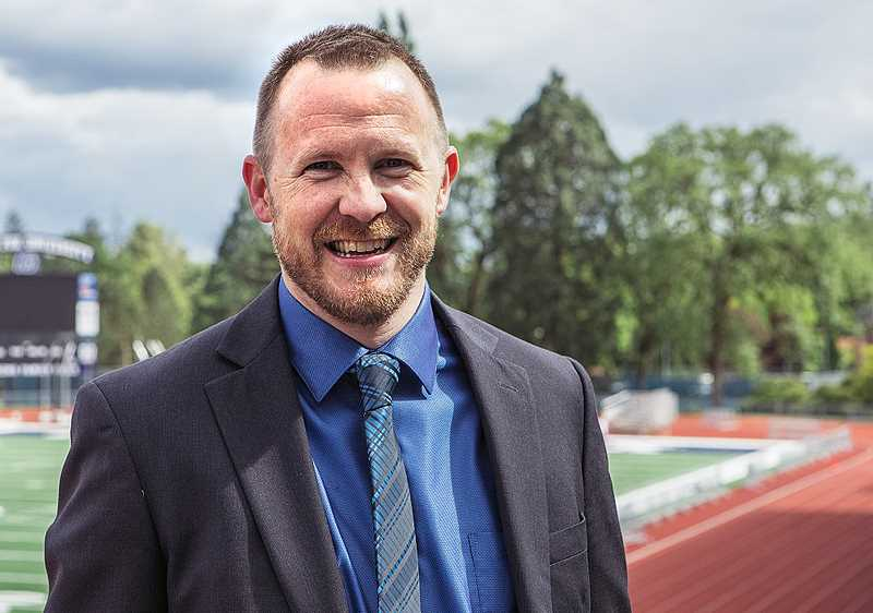 PHOTO COURTESY OF GFU -  George Fox University has named former track athlete and current member of the board of trustees Adam Puckett as its new athletic director.