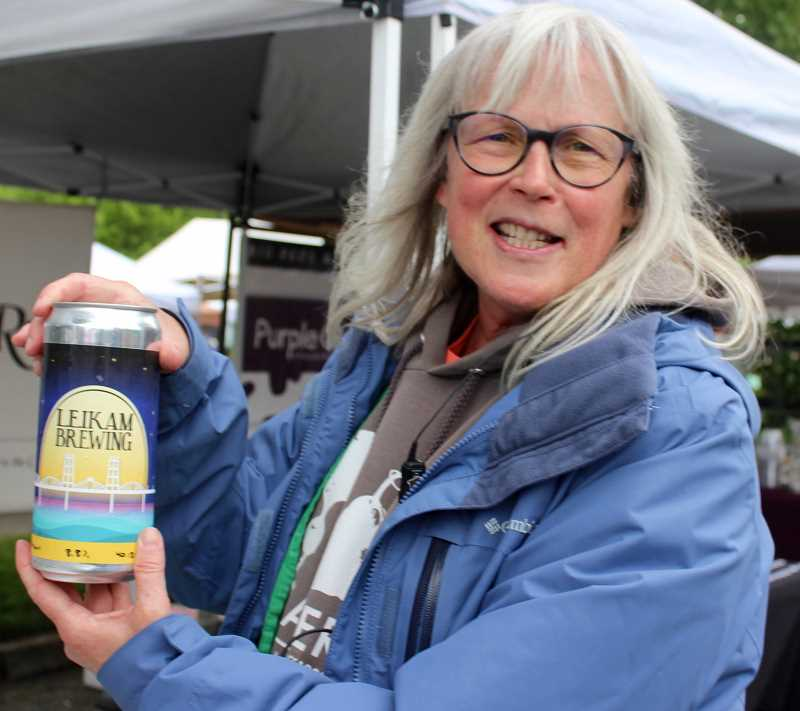 THE TIMES: MANDY FEDER-SAWYER - Beaverton Farmers Market Master Ginger Rapport displays Leikam beer, a kosher nano-brew featured in a booth at the market Saturday, June 3.
