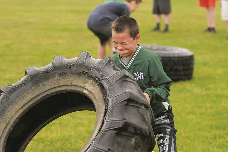 PHIL HAWKINS - The annual Husky Boot Camp is available for athletes of all ages, not just high school students, who want to get in shape over the summer.