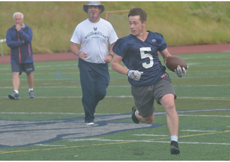 SPOKESMAN PHOTO: COREY BUCHANAN - Wilsonville running back Cooper Mootz dashes up the field in the game that culminated a week of practice for the Wildcat football team.