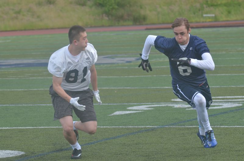 SPOKESMAN PHOTO: COREY BUCHANAN - Defensive back Austin Kness defends receiver Jacob Herr out wide.