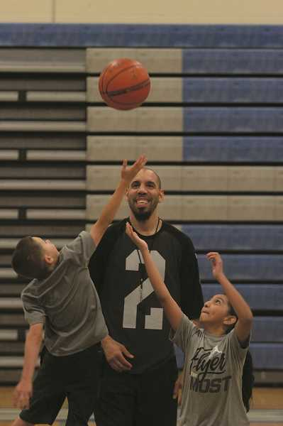 PHIL HAWKINS - Woodburn varsity boys basketball coach Ryan Slider referees at last year's Junior Bulldog Basketball Camp.