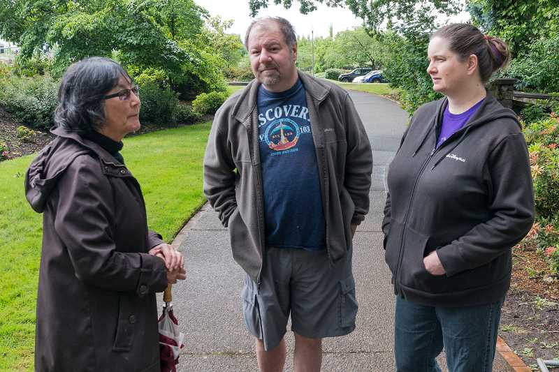 HILLSBORO TRIBUNE PHOTO: CHRISTOPHER OERTELL - Valerie Otani, Hillsboro Public Art Program Supervisor, talks with Geoff and Kim Zerbe about the removal of the Chief Kno-Tah statue at Shute Park. Geoff said hes sad to see the statue go but understands the city needs to remove it after it was damaged in February.