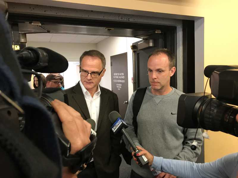 HILLSBORO TRIBUNE PHOTO: GEOFF PURSINGER - Rich Jones, left, and Chris Laube address reporters at Washington County Circuit Court after the verdict was read. Jones, a pastor in Hillsboro, said that the family can begin to heal now that justice has been served.