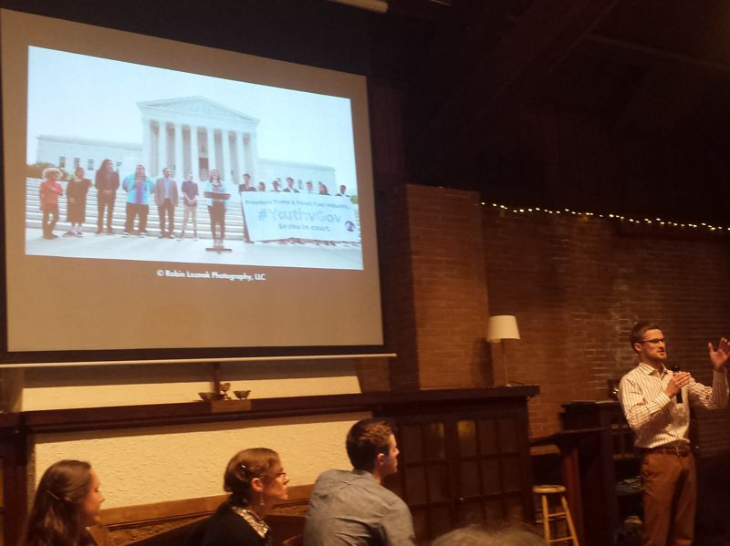 PAMPLIN MEDIA GROUP: JENNIFER ANDERSON - Gordon Levitt, a young climate law fellow for Our Children's Trust, updates attendees at the recent climate change forum on the status of his organization's lawsuit against the federal government.