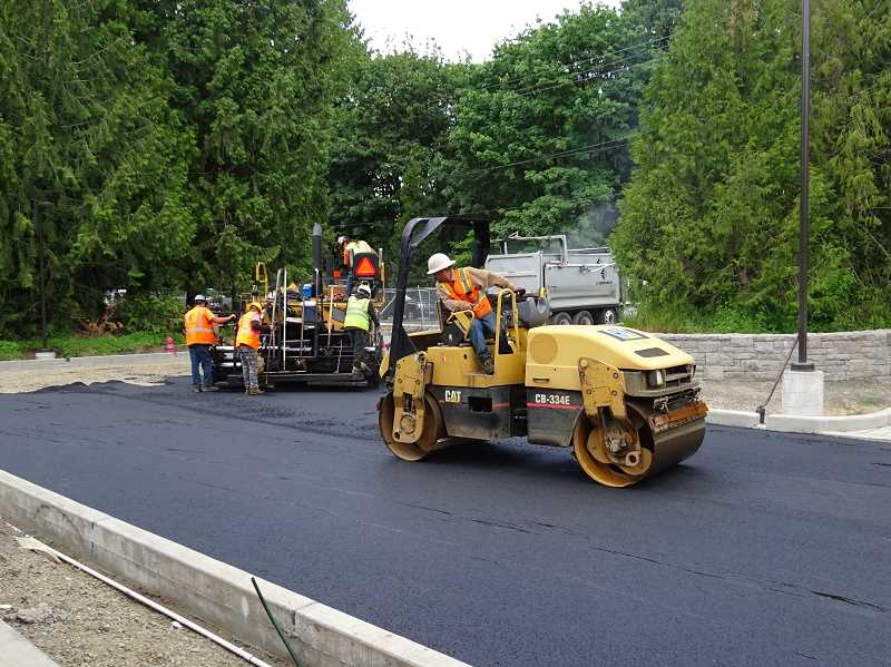SUBMITTED PHOTO - Contractors worked recently on paving at the entrance of the plant.