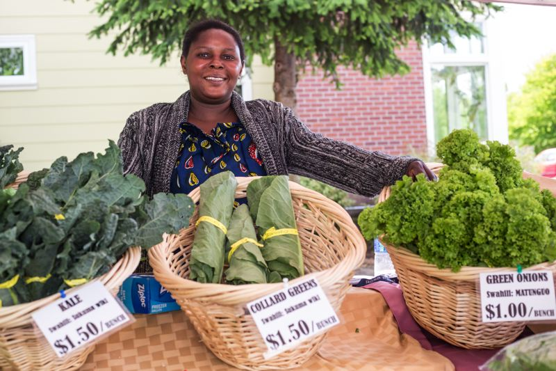 TIMES PHOTO: JONATHAN HOUSE - Rosata Niyonzima with her produce at the Village Gardens Farmers Market.