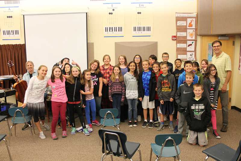 SPOKESMAN PHOTO: ANDREW KILSTROM - Ben Buehler's fifth-grade class takes a picture before their last day with John Nilsen.