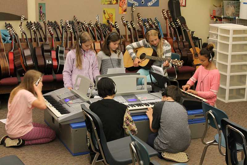 SPOKESMAN PHOTO: ANDREW KILSTROM - Boones Ferry fifth-graders fine tune their songs before performing in front of the class.