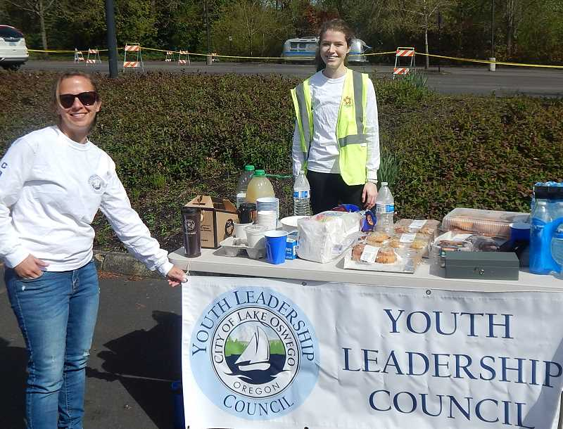 REVIEW PHOTO: ANTHONY MACUK - City Sustainability and Management Analyst Jenny Slepian and Youth Leadership Council co-chair Isabelle Cullen stand behind the council's table at Lake Oswego's Shred Day. The council has volunteered at several Lake Oswego events in its first eight months.