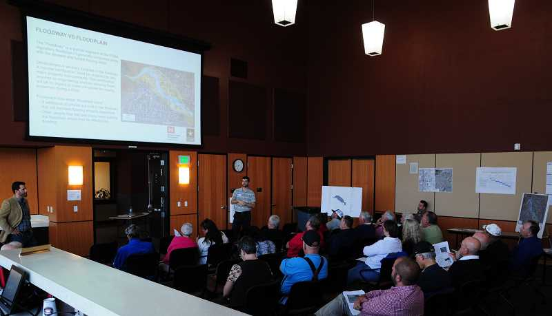 BILL VOLLMER - Nick Snead, Madras Community Development Department director, at left, gathers input from local residents for the city's Floodplain Remapping Project, which the city kicked off on June 8.