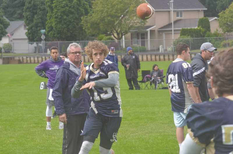 HERALD PHOTO: COREY BUCHANAN - Canby quarterback Trent Wakefield drops back to pass against Sunset in a 7-on-7 scrimmage Saturday, June 10.