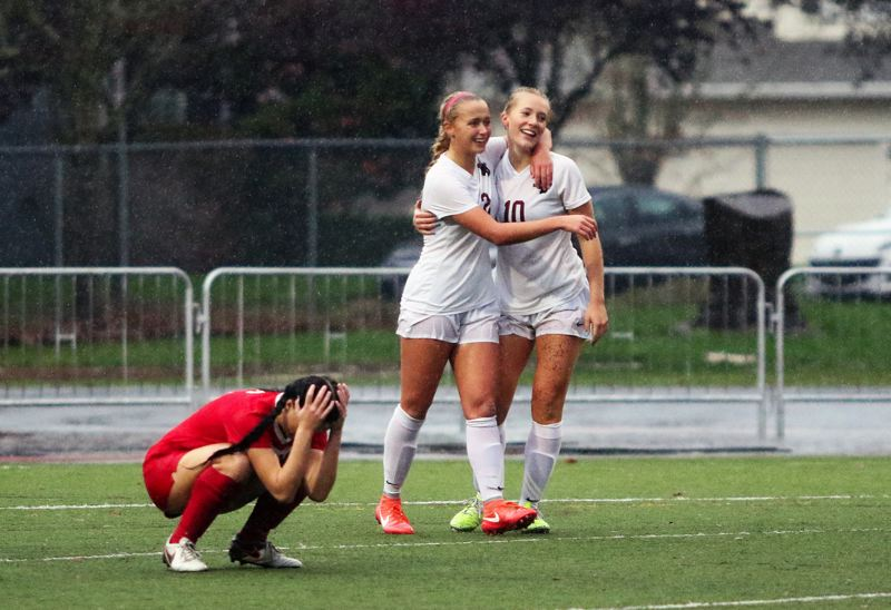 DAN BROOD - Sherwood High School seniors Lindsay Howard (10) and Kaillen Fried (2), shown here during a state playoff win over Oregon City, are among the girls soccer finalists for the Oregon Sports Awards.