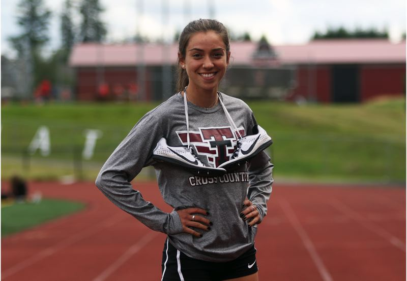 DAN BROOD - Kate Intile shined for the Tualatin cross country and track teams the past four years.