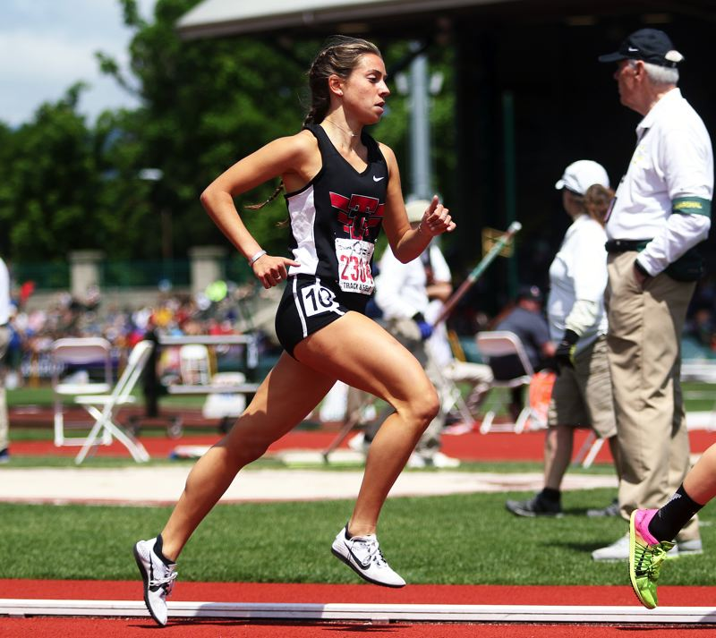 DAN BROOD - Kate Intile strides out in the 1,500-meter run at the Class 6A state track and field championships.