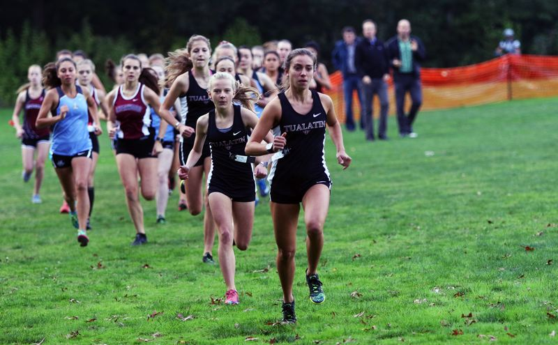DAN BROOD - Tualatin's Kate Intile leads the pack during a Three Rivers League cross country meet.