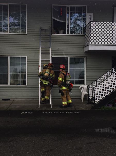 PHOTO COURTESY OF COLUMBIA RIVER FIRE AND RESCUE - Columbia River Fire and Rescue crews put out a kitchen fire in a first-floor apartment, Tuesday, June 13. Firefighters were on scene for half an hour making sure the fire was out and smoke was cleared from the building.