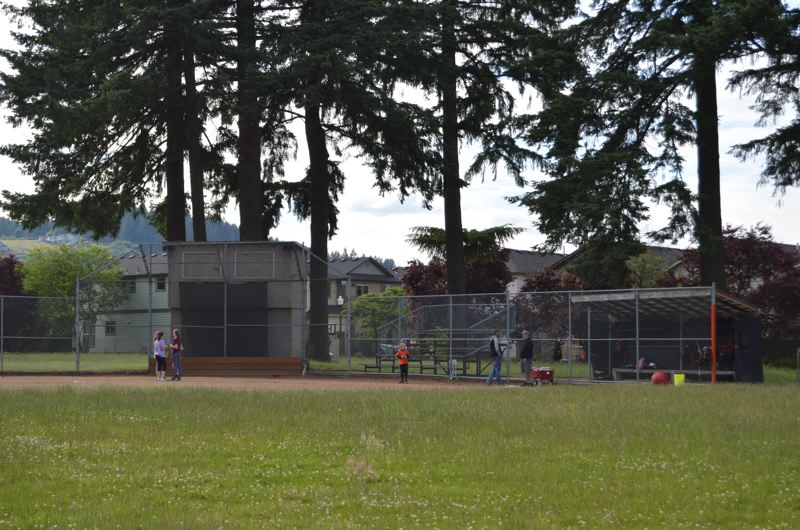 SPOTLIGHT PHOTO: NICOLE THILL - The Scappoose High School varsity softball team practices on a field just off 3rd Street in Scappoose, adjacent to the school district office. The school board is in the process of upgrading the facility to comply  with federal anti-gender discrimination rules.
