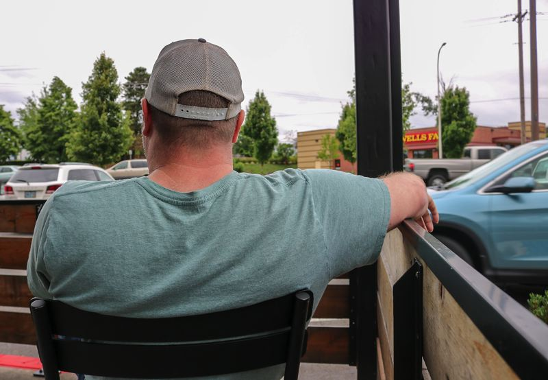 OUTLOOK PHOTO: ZANE SPARLING - Ian Lenon gazes out into a parking lot off Northeast Burnside Road in Gresham.
