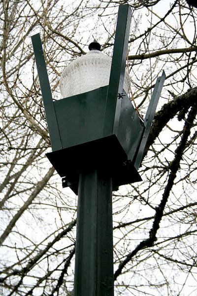 COURTESY PHOTO: ERNESTINA FUENMAYOR - Peacock Lane still has nine of its 11 original gas streetlights that were installed in the 1920s. The lights were converted to electricity in 1930.