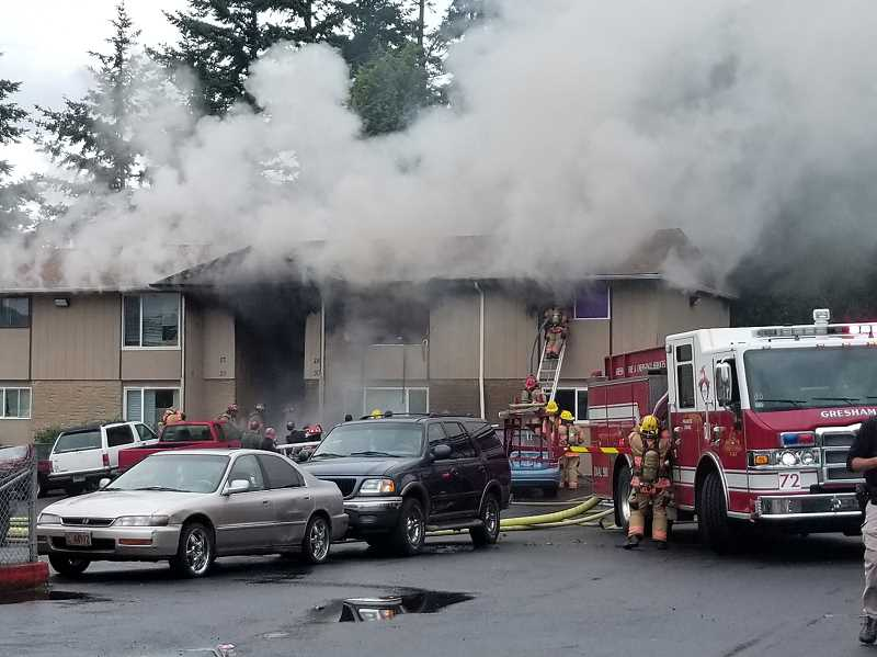 SUBMITTED PHOTO - An Outlook reader submitted this photo of today's fire at the Rosewood Commons apartment complex in Gresham.