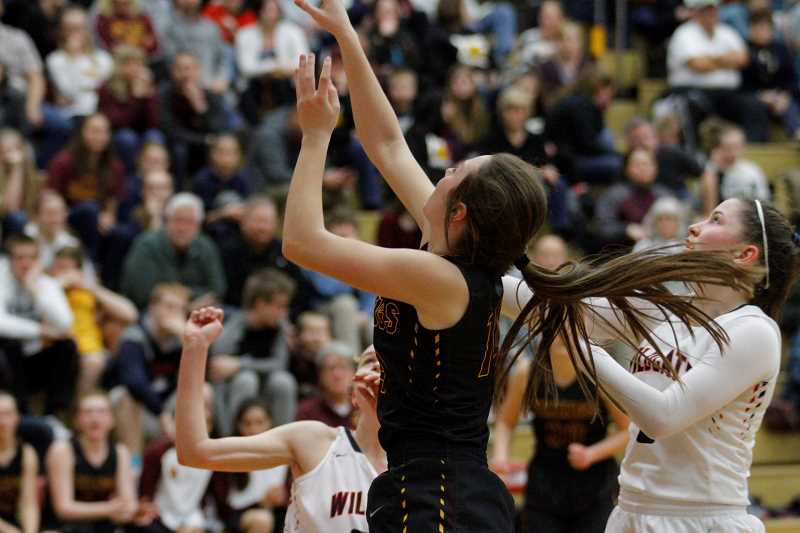 NEWS-TIMES PHOTO: WADE EVANSON - Forest Grove's Emily Huson goes up for a shot during the Vikings' playoff loss at Westview.