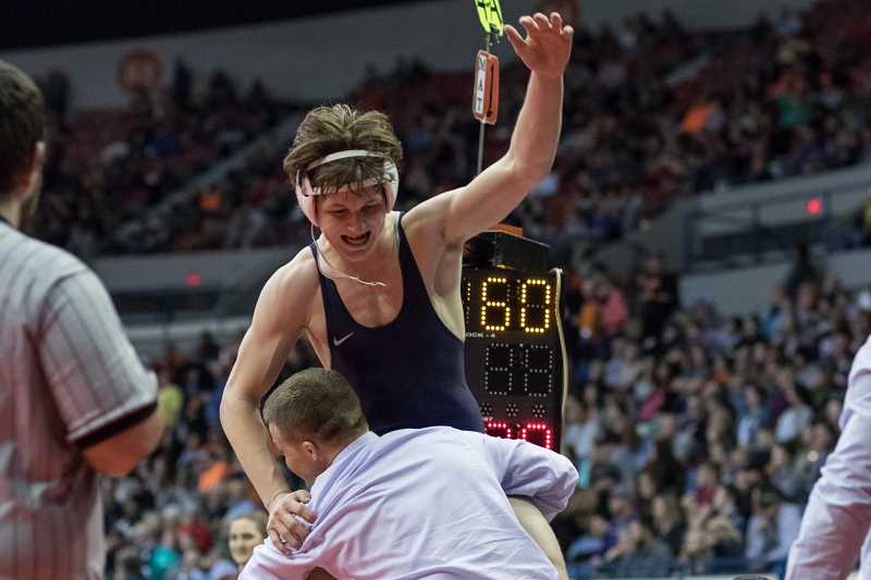 NEWS-TIMES PHOTO FILE: CHASE ALLGOOD - Banks' Trevor Thiessen celebrates after winning a dramatic state final at the OSAA 4A state wrestling championships at the Memorial Coliseum.