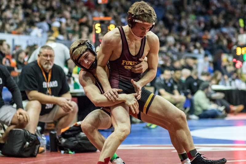 NEWS-TIMES PHOTO STOCK: CHASE ALLGOOD - Forest Grove's Lucas Higginbotham placed third in the 132-pound weight class at the OSAA 6A state wrestling championships in Portland.