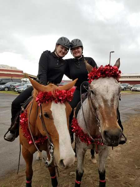 COURTESY PHOTO - Abigail and Anna Dillavou pose for a photo during the state high school equestrian championships in Redmond last month.