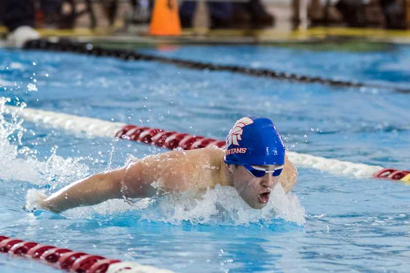 HILLSBORO TRIBUNE PHOTO STOCK: CHASE ALLGOOD - Hillsboro's Matthew Arnold swims the 100-yard butterfly at last year's OSAA 5A state swimming championships at Mt. Hood Community College.