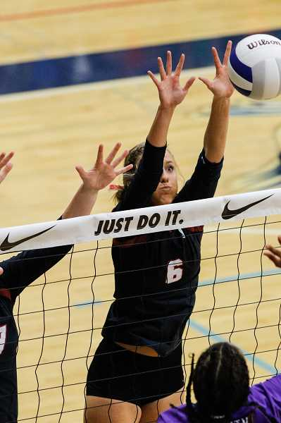HILLSBORO TRIBUNE FILE PHOTO: CHASE ALLGOOD - Glencoe's Abby Anderson goes up to block a ball during the Tide's state tournament game against South Eugene.