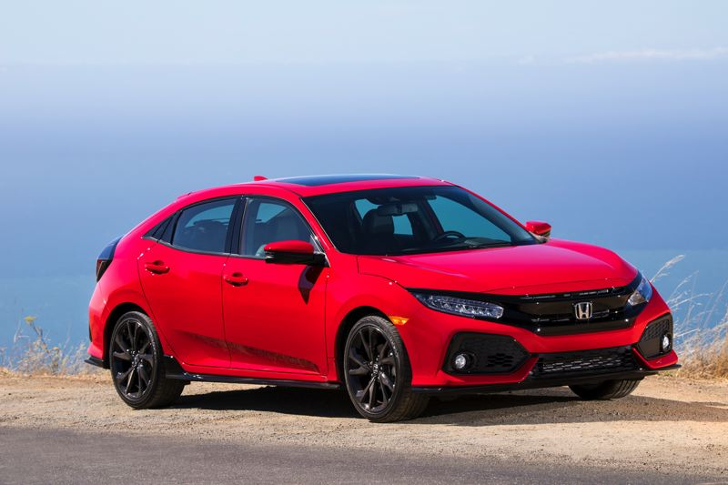 HONDA AMERICA MOTOR COMPANY - The new 2017 Honda Civic Hatch Sport is dramatically styled and especailly sure to attract attention in bright red and glossy black.