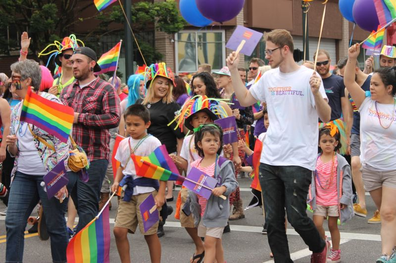 TRIBUNE PHOTO: LYNDSEY HEWITT - Families were a big part of Sunday's Portland Pride Parade, as many celebrated Father's Day at the event.