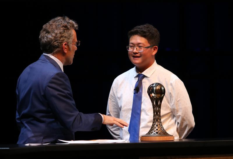 REVIEW/NEWS PHOTO: JIM BESEDA - ESPN's Neil Everett (left) chats on stage with Clackamas' Samuel Pyon after he was named Male Prep Golfer of the Year during Sunday's 65th Oregon Sports Awards show.