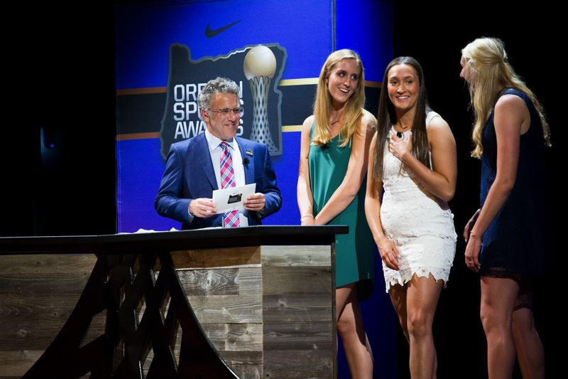 TRIBUNE PHOTO: ADAM WICKHAM - ESPN's Neil Everett, host of the Oregon Sports Awards, chats with Prep Volleyball Player of the Year finalists (from left) Kathryn Decker, Maddie Batiste and Hawley Harrer during Sunday's show at Nike.