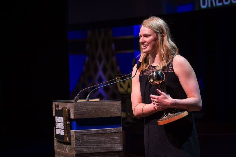 TRIBUNE PHOTO: ADAM WICKHAM - Centennial's Jamie Stone gives thanks as she receives the Prep Swimmer of the Year Award for females at Sunday's 65th Oregon Sports Awards.