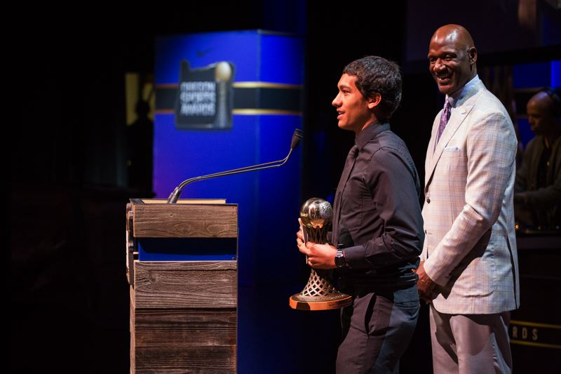 TRIBUNE PHOTO: ADAM WICKHAM - Elijah Gonzales from Clackamas High, flanked by presenter and Trail Blazers legend Terry Porter, is honored Sunday as the Prep Basketball Player of the Year for boys in 2016-17.