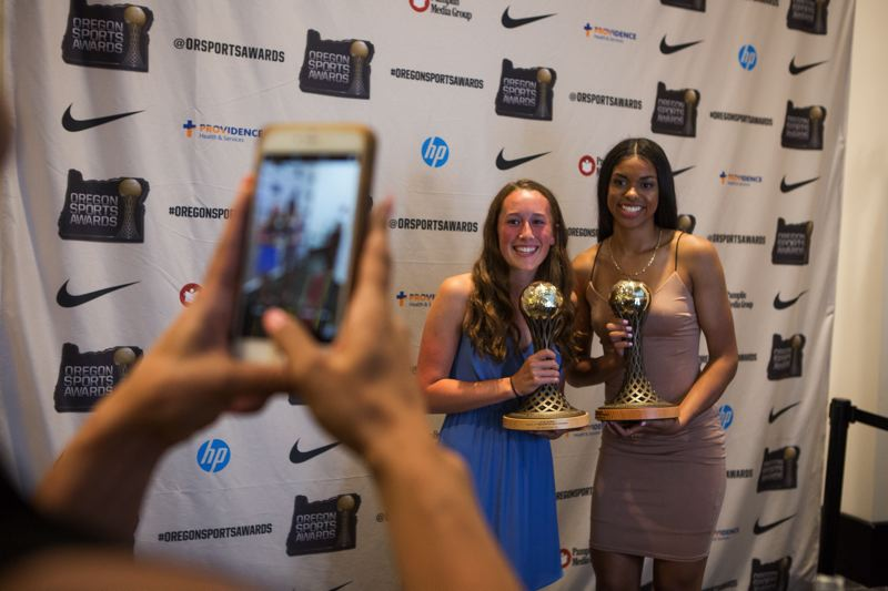 TRIBUNE PHOTO: ADAM WICKHAM - South Salem High athletes Ellie Slama (left) and Evina Westbrook pose for photos after being named, respectively, as the girls Prep Golfer of the Year and Prep Basketball Player of the Year during the 65th Oregon Sports Awards show.