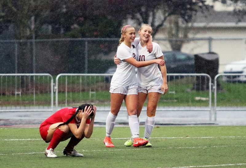 FILE PHOTO: DAN BROOD - Sherwood High School seniors Lindsay Howard (10) and Kaillen Fried (2), shown here during a state playoff win over Oregon City, were both named girls soccer finalists for the Oregon Sports Awards' Female Prep Soccer Player of the Year for the 2016-2017 school year. Fried won the honor during a ceremony held at Nike on June 18.