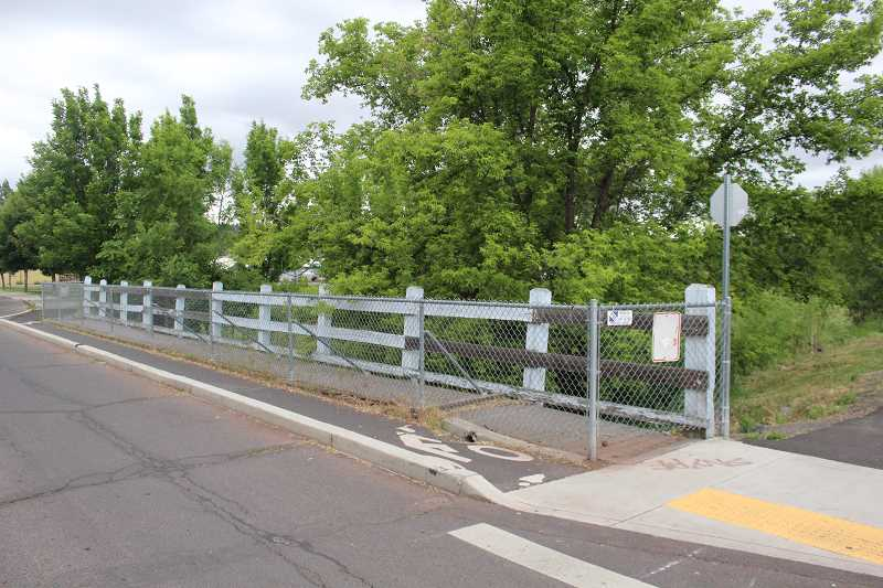 JASON CHANEY/CENTRAL OREGONIAN - The sidewalk along Elm Street Bridge is fenced off, but it will soon be decorated with colorful flagging tape.