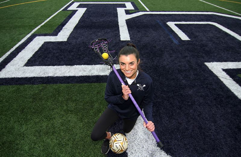 REVIEW PHOTO: MILES VANCE - Lake Oswego senior Lauren Gilbert spent a great deal of her high school life near the big 'LO' on the school's stadium field, starring both soccer and lacrosse for the Lakers.