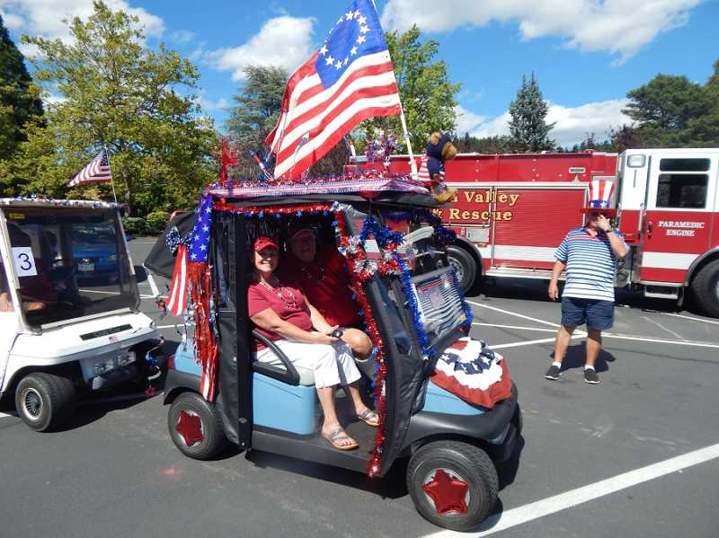REGAL COURIER FILE PHOTO - Several KCCA golf cart owners went all out with patriotic decorations and participated in the July 3, 2016, parade that started and ended at the Clubhouse parking lot with a pass by Pacific Pointe, where the residents voted on the carts with the best decorations.