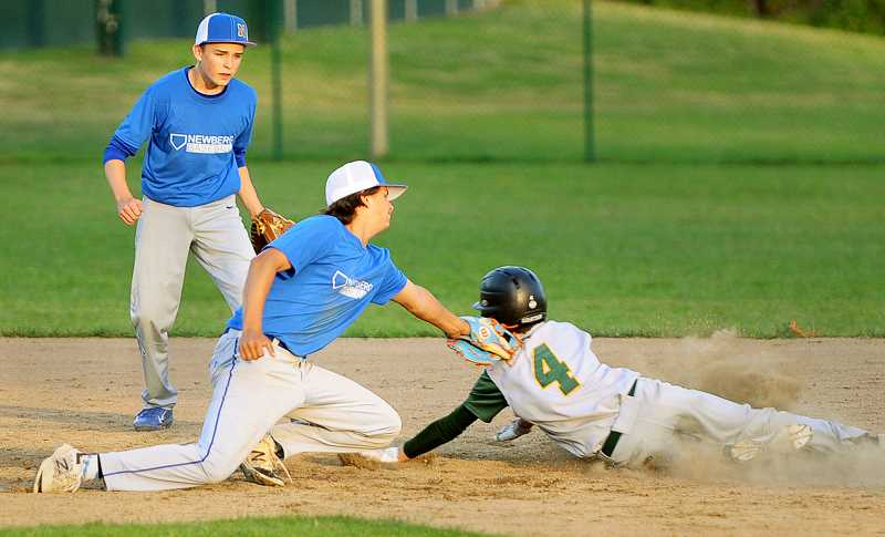 SETH GORDON - Shortstop Connor Nipp tags out a Rex Putnam baserunner trying to steal second base during the Newberg 16U baseball team's 8-5 road loss June 14. The Tigers are 7-6 so far this summer.