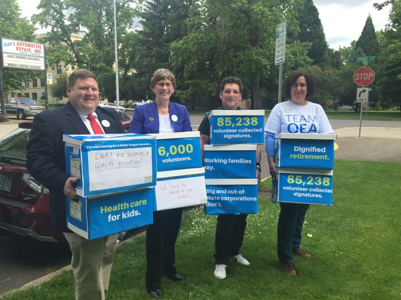 FILE PHOTO - Petitioners for Initiative Petition 28, Measure 97, bring signatures to the Secretary of State's Office in Salem last year.