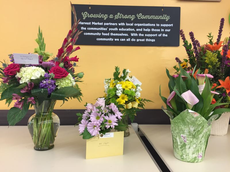 FILE PHOTO - Harvest Market and several other locations around town were filled with flowers, cards and positive thoughts for Wagner.