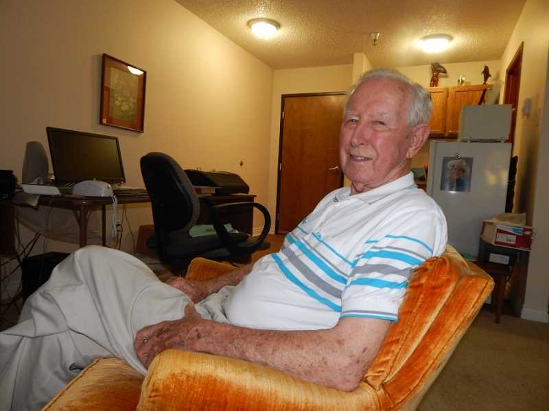 BARBARA SHERMAN - Bob Santee relaxes in his Summerfield Estates home, where he has lived for about three years after originally becoming one of Summerfield's first residents with his wife after the new community opened.