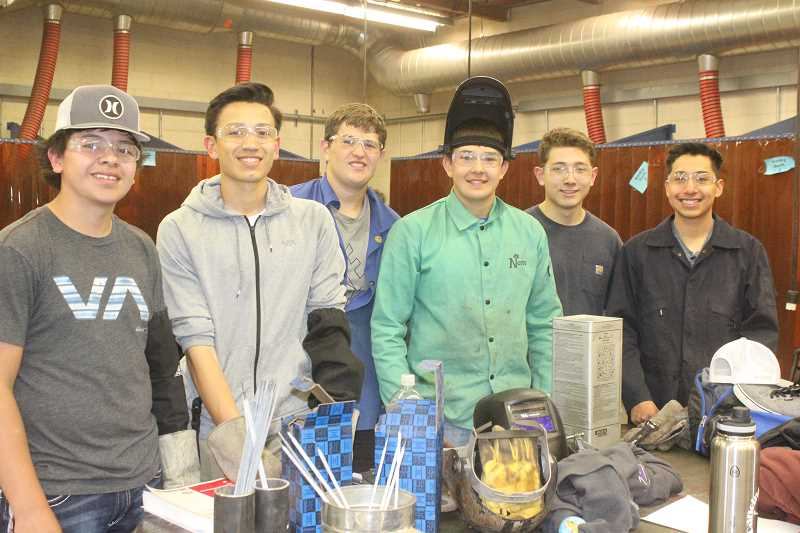SUSAN MATHENY/MADRAS PIONEER - Attempting to pass the welding certification test June 15 were MHS students, from left, Kobe Serrano, Byron Patt, William Lemus, Kody Zemke, Colton Reese and Juan Huerta.