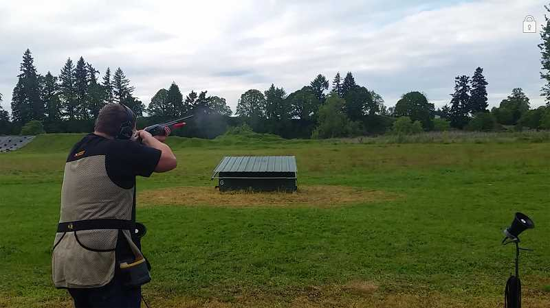 SUBMITTED PHOTO - A Wilsonville High trap shooter aims for the clay target at Canby Rod and Gun Club.
