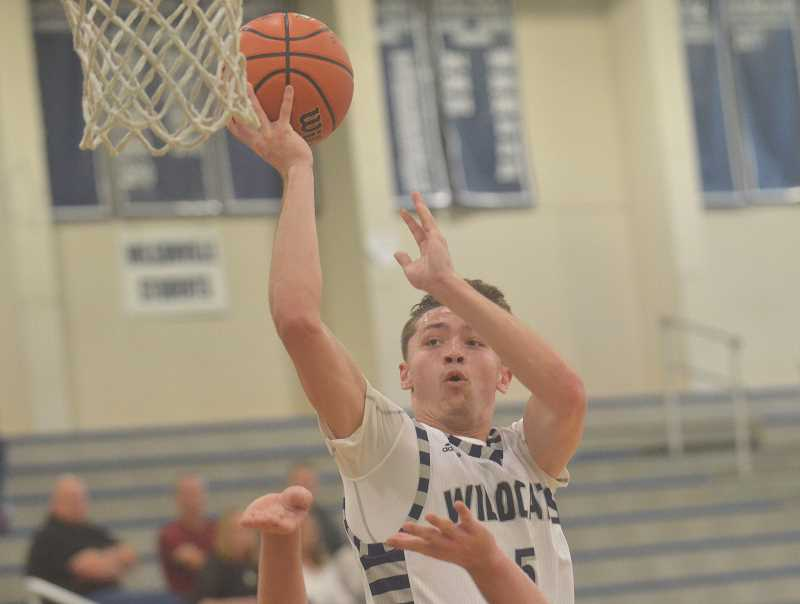 SPOKESMAN PHOTO: COREY BUCHANAN - Wilsonville 2017 graduate Harrison Steiger scored 19 points on 9-of-11 shooting during the game on Saturday.